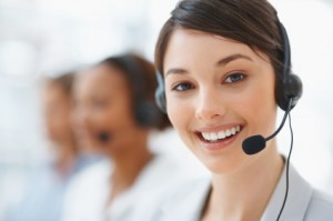 Close up of a beautiful business customer service woman smiling