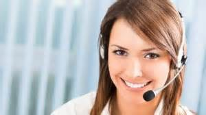 nice lady smiling with brown hair wearing a headset calling